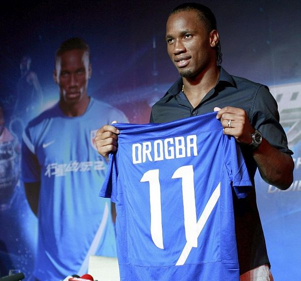 Really, Didier? Drogba insists Shanghai move isn't about the money... as he's unveiled in £270k-a-week role