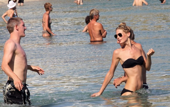 Bastian Schweinsteiger went on a summer beach vacation with his girlfriend