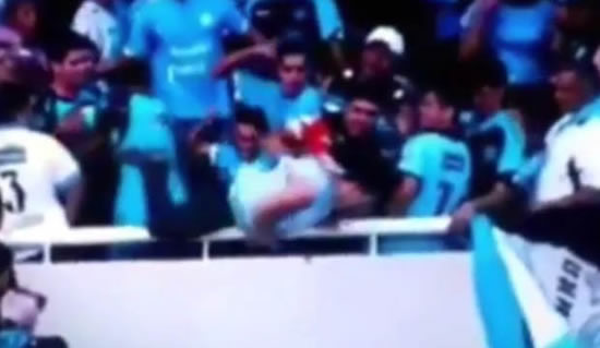 Footie fan suffers brain damage after his OWN team throw him over the stands in horror vid
