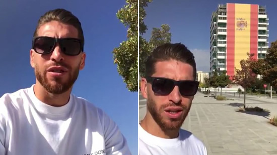 Sergio Ramos is amazed by a huge Spanish flag