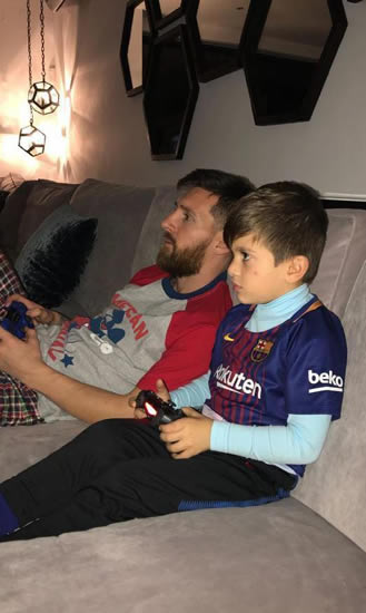 Lionel Messi and son Thiago face off on Fifa 18 as wife Antonella captures family battle