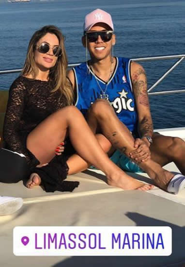 Liverpool star Roberto Firmino continues bizarre fashion trend with pink cap and glasses with neck strap as Liverpool ace suns himself on yacht