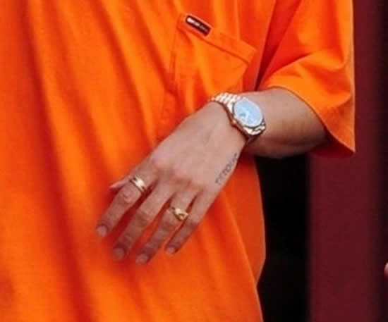 Arsenal star Hector Bellerin shows off luxury watch and rings in striking orange outfit while out in London sun