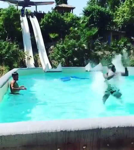 Mario Balotelli almost smashes his head on side of swimming pool as Nice star flies off end of slide