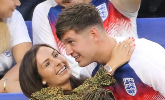 England's John Stones puts on loved-up display with his new girlfriend after dressing room jibes