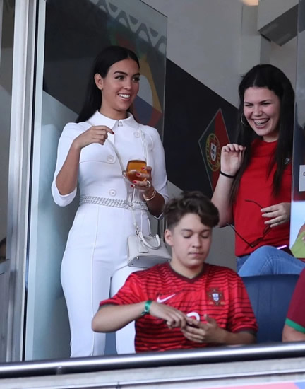 Georgina Rodriguez drinks wine and stuns in white jumpsuit as she cheers Cristiano Ronaldo onto latest trophy win