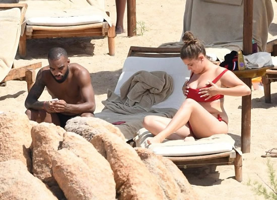 Alexandre Lacazette relaxes on beach with mystery busty brunette ahead of return for Arsenal pre-season