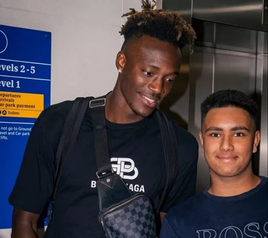 TAM OFF Tammy Abraham gets over England snub by jetting to Barcelona with girlfriend… and posing for a selfie with a fan