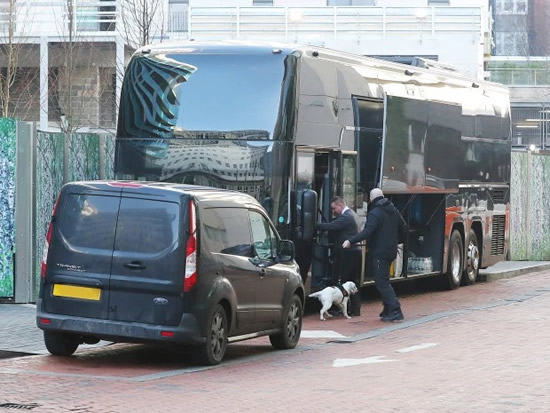 RUFF START Man Utd coach checked by sniffer dog amid security fears as Solskjaer's squad leave The Lowry for Liverpool clash